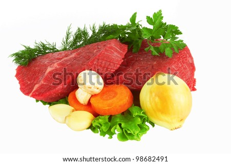 raw meat and vegetables on white - stock photo