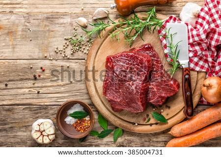 raw meat beef steaks - stock photo
