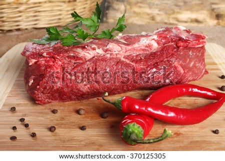 Raw meat beef, thick edge on a wooden board - stock photo