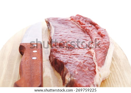 raw meat beefsteak fillet with knife on wood isolated over white background - stock photo