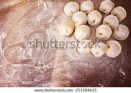 Raw Meat dumplings Russian traditional pelmeni with meat - stock photo
