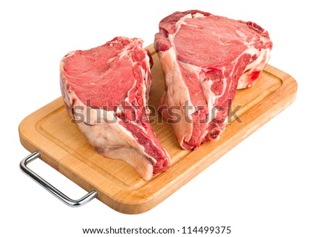 raw meat : fresh beef pork big rib and fillet on wooden board, isolated over white background - stock photo