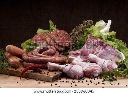 Raw meat mix: steaks, poultry, sausages, pork, chopped, minced. - stock photo