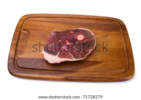 Raw meat on the wooden board. Isolated on white background. - stock photo