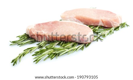 Raw meat steak with herbs isolated on white - stock photo