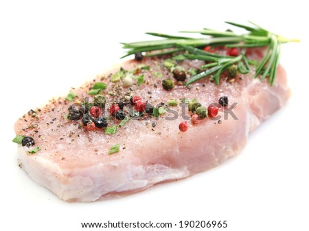 Raw meat steak with spices and herbs isolated on white
