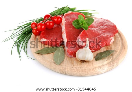 raw meat with fresh vegetables isolated on white background - stock photo