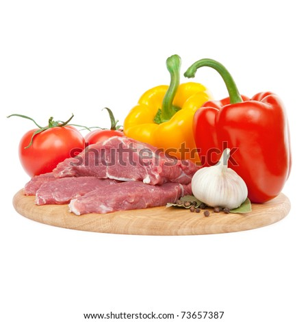raw meat with peppers, tomatoes and garlic ingredients - stock photo