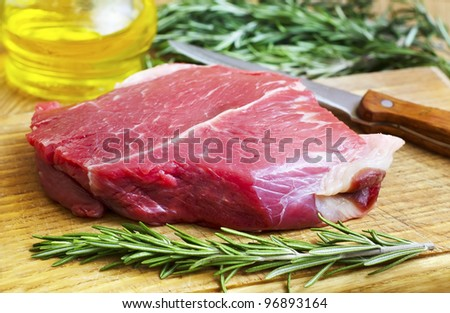 raw meat with rosemary - stock photo