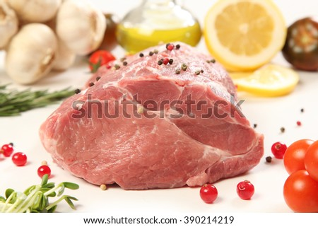 raw meat with vegetables on white