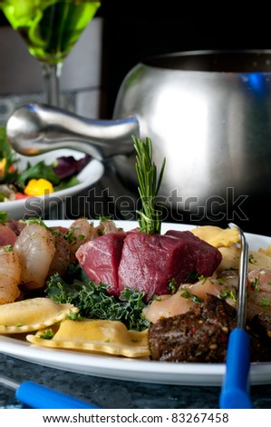 Raw meats and seafood for Fondue dining - stock photo