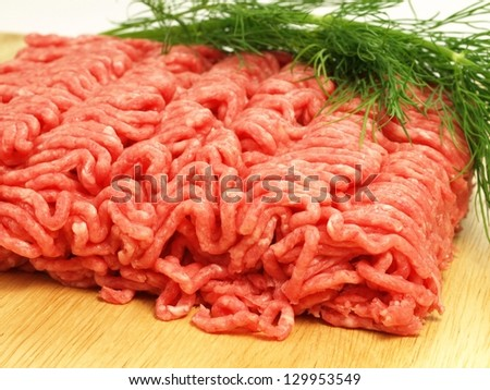 Raw minced beef with dill, close up - stock photo