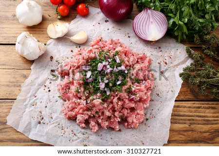 raw  minced meat on rustic background - stock photo