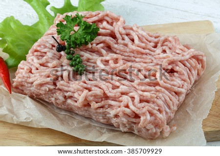 Raw minced meat with pepper and parsley ready for cooking - stock photo