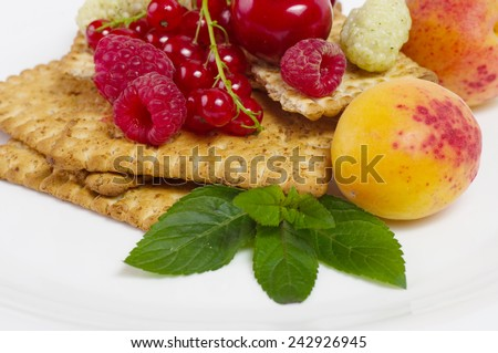 Raw mix berry and tasty cake  - stock photo
