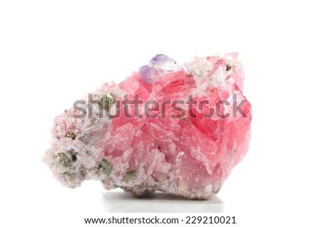Raw natural pink rhodochrosite with pyrite and fluorite on white background - stock photo