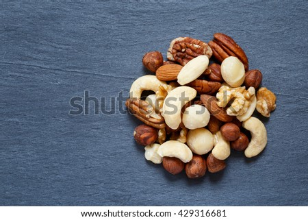 Raw nuts on dark background