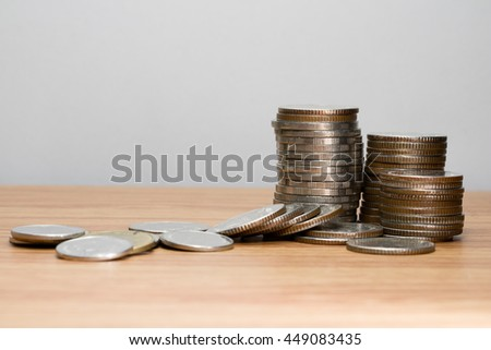 Raw of coins on wooden floor business finance concept.