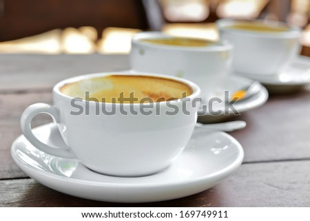 Raw of empty cappuccino coffee cup - stock photo