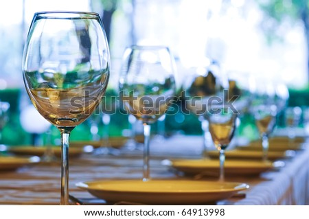 Raw of wineglasses on the arranged table. Closeup. - stock photo