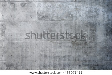 Raw or bare concrete wall, with nice texture and seams and dimples.
