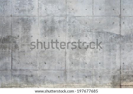 Raw or bare concrete wall, with seams and dimples. - stock photo
