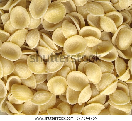 raw orecchiette pasta from Apulia, Italy, useful as a background