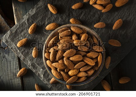Raw Organic Brown Almonds in a Bowl - stock photo