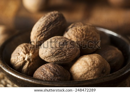 Raw Organic Dry Nutmeg to Use as a Spice - stock photo