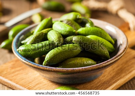 Raw Organic Green Finger Limes Ready for Eating - stock photo