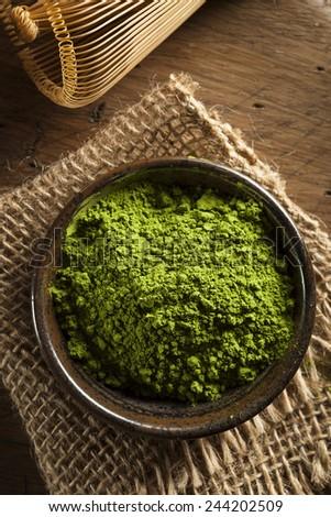 Raw Organic Green Matcha Tea in a Bowl - stock photo