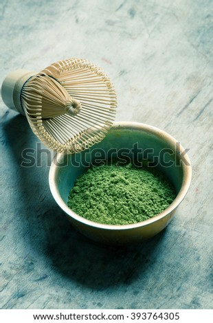 Raw Organic Green Matcha Tea in a Bowl/toned photo - stock photo