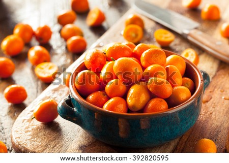 Raw Organic Orange Kumquats in a Bowl - stock photo