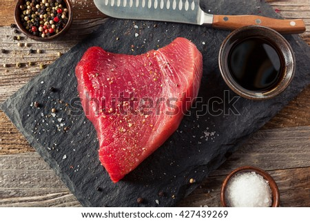 Raw Organic Pink Tuna Steak with Salt and Pepper - stock photo