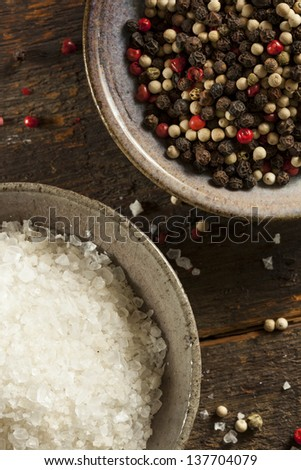 Raw Organic Sea Salt and Pepper against a background - stock photo