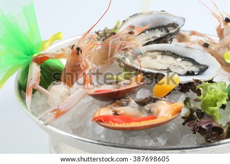 raw oysters with ice and scampi - stock photo