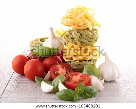 raw pasta and ingredients - stock photo