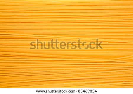 raw pasta as whole background - stock photo