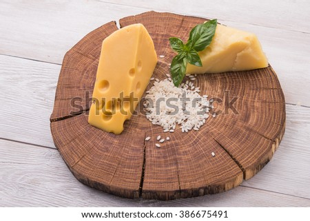 raw pasta, green basil and chesse on wooden table