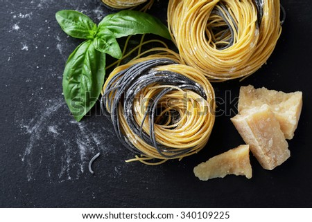 raw pasta on slate, food top view - stock photo