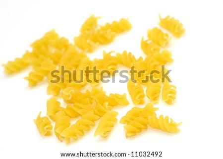 raw pasta on white background - stock photo