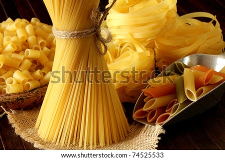 raw pasta on wood background