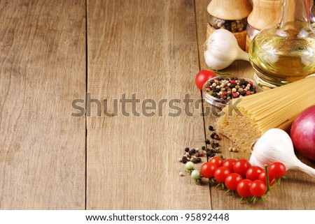 Raw pasta vegetables olive oil and spices with copy-space - stock photo