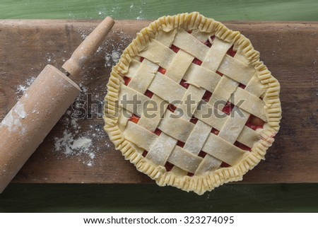raw pie on wooden surface - stock photo