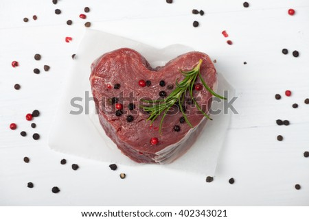 raw piece of beef loin on wood  - stock photo