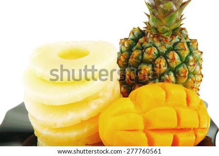 raw pinapple on black plate isolated over white background - stock photo