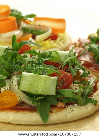 Raw pizza with a lot of vegetables - stock photo