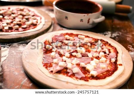Raw Pizza with ham - stock photo