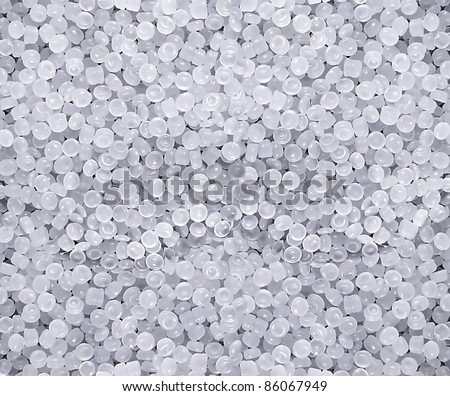 raw plastic material white granules - stock photo