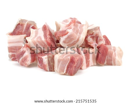 Raw pork belly pieces on a white background - stock photo